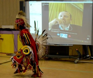 Young chicken dancer practices his moves while Chief Tony Alexis watches on Skype
