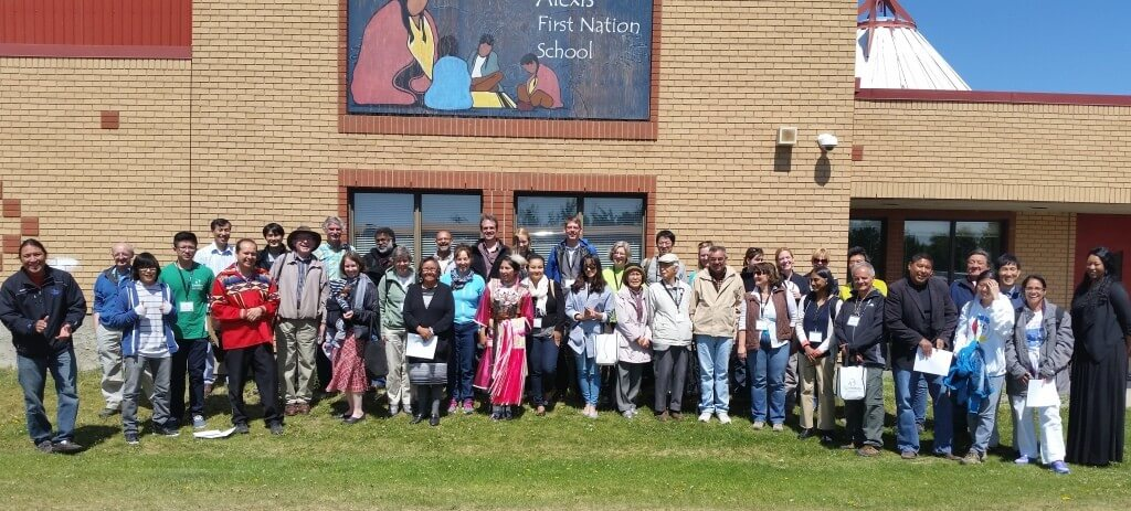IASC Group and hosts in front of the Alexis Sioux First Nation school