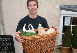 man with basket of food suschain 270px